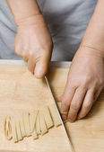 Noodles preparation from dough in home cuisine — Stock Photo
