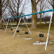 Swing set on the playground — Stock Photo