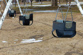 Swing set on the playground — 图库照片