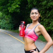 Fit young woman with water bottle after running — Stock fotografie