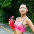 Fit young woman with water bottle after running — Stock Photo