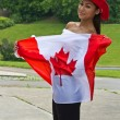 Beautiful girl with a Canada flag — Stok fotoğraf
