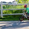 Child bicycling on the bike path in the park — Stock Photo #30102205