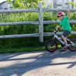 Stock Photo: Child bicycling on bike path in park