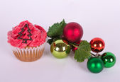 Christmas tree ornament and cupcake with tree — Stock Photo