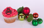 Christmas tree ornament and cupcake — Stock Photo