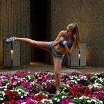 Sexy mixed-martial arts (MMA) woman kicking — Stock Photo