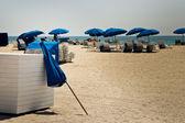 Sun umbrellas on a sandy beach — Stock Photo
