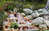 Decorative waterfall in a garden — Stock Photo
