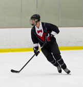 Man playing ice hockey — Stock Photo