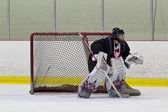 Ice hockey goalie ready to make a save — Stock Photo