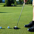 Stock Photo: Practicing golf putting with several balls
