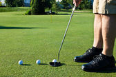 Practicing golf putting with several balls — Stock Photo
