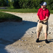 Stock Photo: Golfer practicing from sand bunker