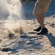 Stock Photo: Golf player hitting ball from sand bunker