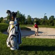 Stock Photo: Golfer prepares to hit golf ball from sand trap