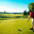 Stock Photo: Golfer hitting ball on tee - filter