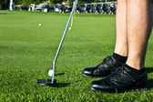 Golf player putting the ball — Stock Photo