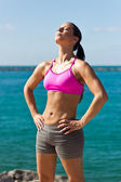 Fit woman worshiping the sun  — Stock Photo