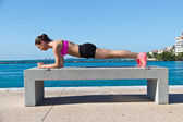 Hispanic woman doing a pilates plank for fitness — Stock Photo