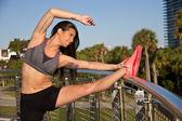Beautiful hispanic woman stretching for fitness — Stock Photo