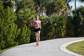 Hispanic girl running along a path — Stock Photo