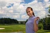 Woman golfer stretching with a golf club — Stock Photo