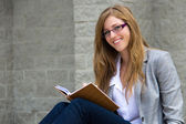 Smart young young reading her journal — Stock Photo