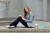 Woman student studying on campus — Stock Photo
