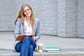 College student writing in a journal - filter applied — Stock Photo