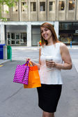 Happy girl shopping downtown — Stock Photo