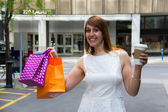 Happy day shopping in the city — Stock Photo