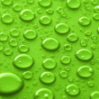 Green water drops — Stock Photo