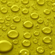 Yellow water drops — Stock Photo