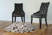 Two Black Chairs In Minimalist Interior With Stack Of Money On Laminate — Stock Photo