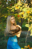 Fashion portrait of young sensual woman in garden — Stock Photo