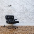 White Brick Wall Interior With Black Leather Office Armchair — Stock Photo #46493267