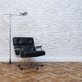 White Brick Wall Interior With Black Leather Office Armchair — Stock Photo