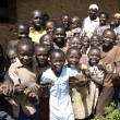 A groupe of African Children smiling behind af barbwirefence. — Stock Photo