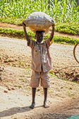 Small african boy with a large bag of coffeebeans — Stock Photo
