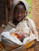 Young african girl with newborn baby — Stock Photo