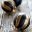 Three christmas ornaments in gold and blue — Stock Photo