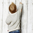Little Boy drawing in a fence — Stock Photo