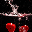 Stock Photo: Valentine hearts make a splash