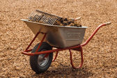 A wheelbarrow full of horse shit — Stock Photo