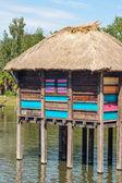 Colorful stilt village in africa floating — Stock Photo