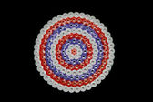 Colorful abstract shape of plastic beads pieced by child — Stock Photo