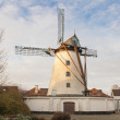 Stock Photo: Vintage stone windmill in flanders belgium