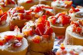 Bruschetta with tomato mozzarella garlic and fresh herbs — ストック写真
