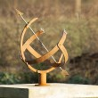 Iron sundial in the garden ancient clock — Stock Photo #39042763